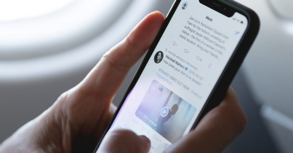 Twitter on the screen of a phone that someone is holding