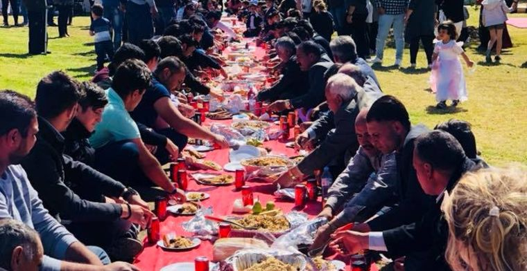 Refugees and Australians gather together at a You Belong Welcome Picnic.