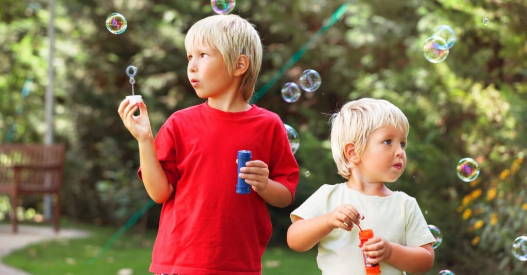 boys blowing bubbles
