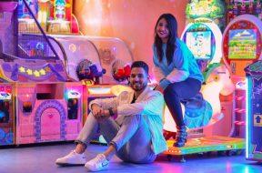man-and-woman-sitting-in-an-arcade-2.jpg