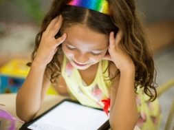 young-girl-smiling-at-an-iPad-2.jpg