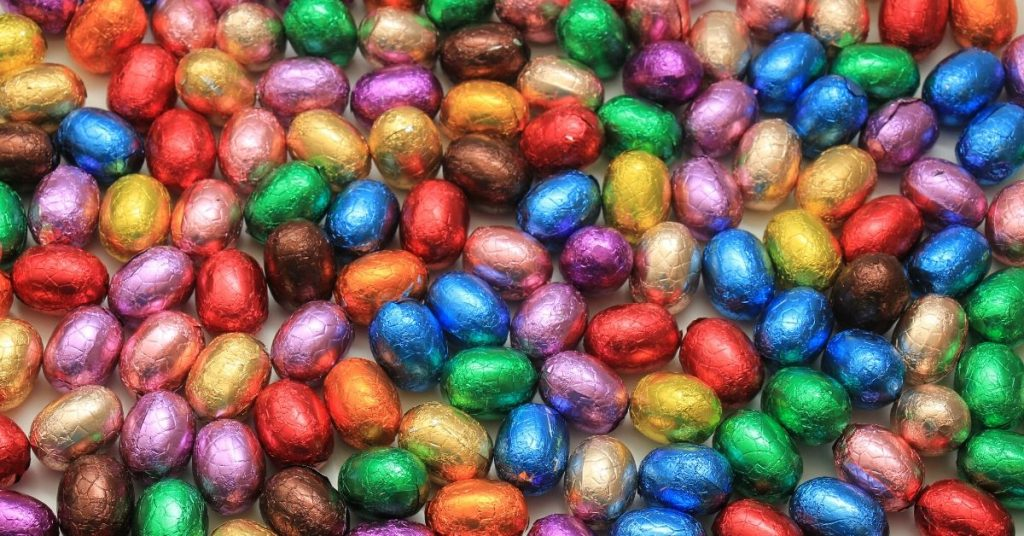 photo of a pile of different coloured chocolate easter eggs