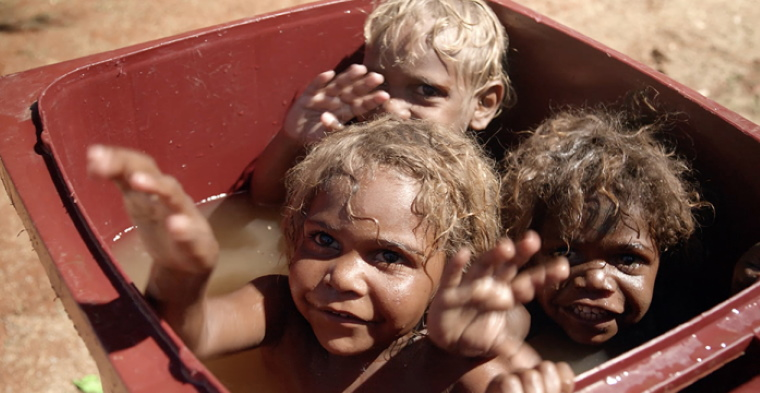 Next generation: Warakurna kids Gordon, Garrick Jnr and Tristan Robinson have a bright future as some of the troubled culture of the past has changed for the better. Photo: Cinema Australia