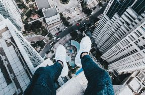 man-sitting-on-edge-of-building-unsplash.jpg
