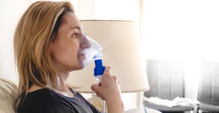 woman using a nebuliser