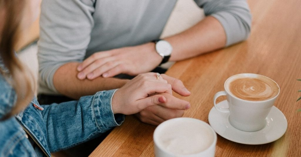 couple having a conversation over coffee