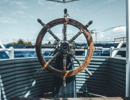 boat-steering-wheel-joseph-barrient-unsplash.jpg