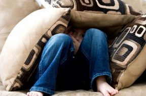 boy-hiding-under-cushions-pexels-pixabay.jpg