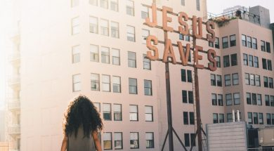 woman-jesus-saves-sign-edwin-andrade-unsplash.jpg