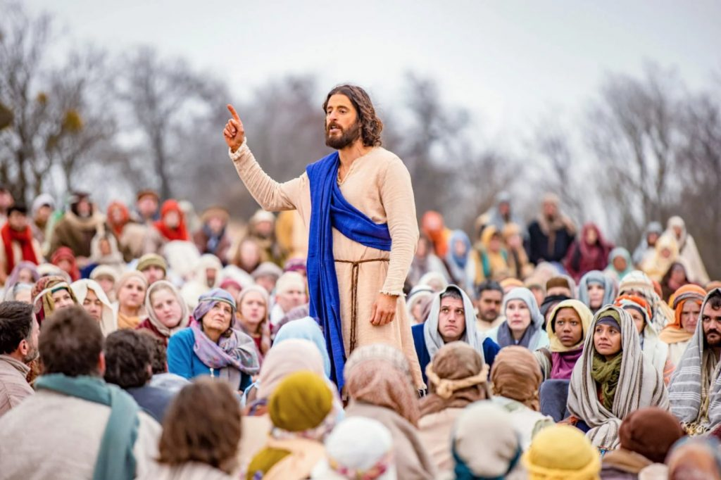 film still from the chosen - jesus speaks to a crowd